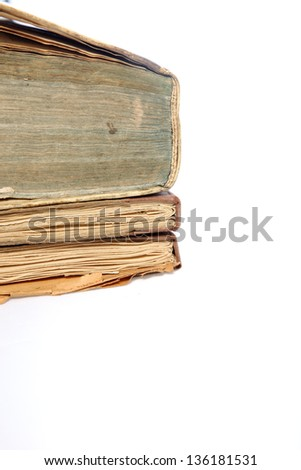 Pile of three old discoloured vintage books with worn pages, partial view isolated on white - stock photo