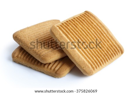 Pile of three square Italian shortbread honey and milk biscuits with ridges, isolated on white in perspective.