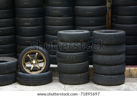 Pile of tires and wheels for rubber - stock photo