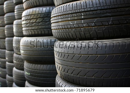 Pile of tires and wheels for rubber. Closeup for design work - stock photo