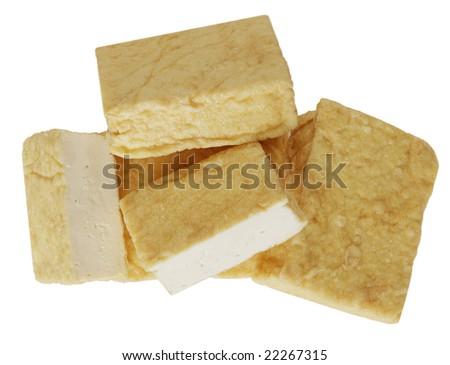 Pile of tofu blocks isolated on white - stock photo