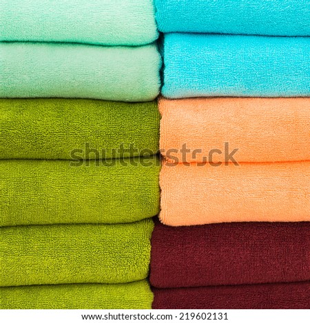 Pile of towels with beautiful colors. - stock photo