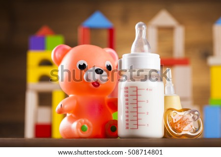 Pile of toys, collection on wooden background