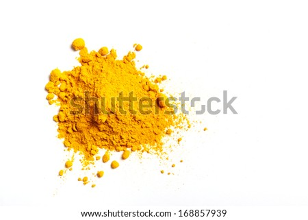 Pile of Turmeric powder isolated on a white background - stock photo