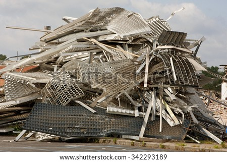 Pile Of Twisted Metal And Debris Sits On Demolition Site. - stock photo