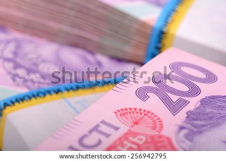 Pile of ukrainian money, ukrainian hryvnia - stock photo