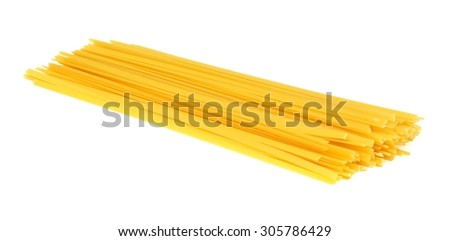 Pile of uncooked dry fettuccine pasta isolated on a white background - stock photo