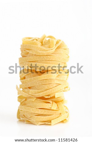 Pile of uncooked fettuccinne isolated