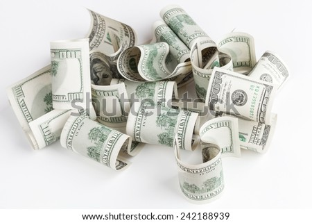 Pile of United States dollar hundred USD banknotes on white table. Selective focus
