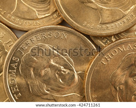 Pile of US Gold Presidential Dollar Featuring Thomas Jefferson - stock photo