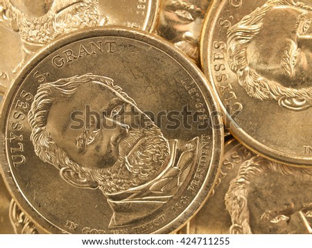 Pile of US Gold Presidential Dollar Featuring Ulysses S Grant - stock photo