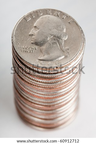 Pile of US qurters coins on white background, sideways