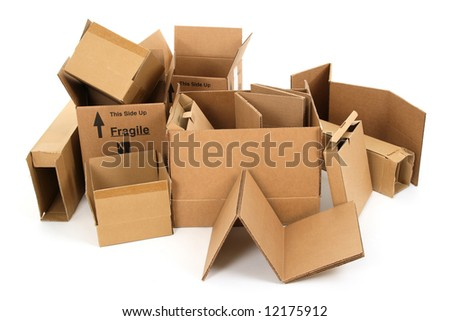 Pile of used cardboard boxes on white background. - stock photo