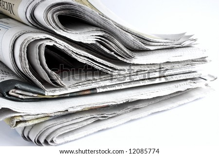pile of used newspapers on a white background