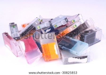 Pile of used olor ink cartridges - stock photo