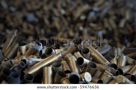 Pile of used pistol and rifle cartridges - stock photo