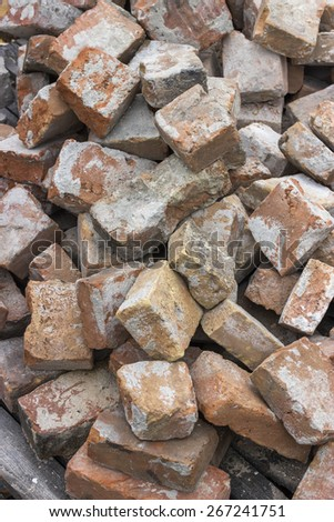 Pile of used red brick, used construction material. Selective focus and shallow dof. - stock photo