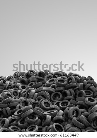 pile of used rubber tyres isolated on gray background high resolution - clean composition - stock photo