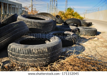Pile of used tires in industrial zone.  - stock photo