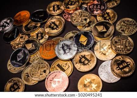 Pile of various Cryptocurrencies (Bitcoin, Ethereum, Litecoin, Ripple)