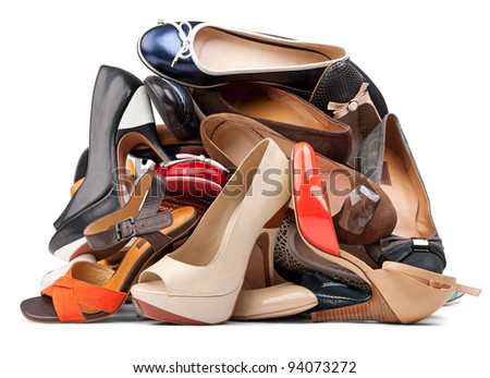 Pile of various female shoes isolated over white, with clipping path - stock photo