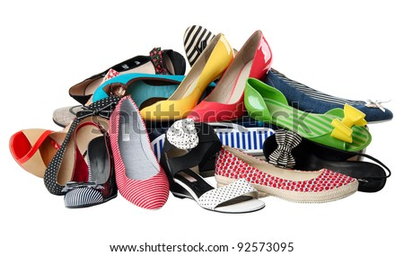 Pile of various female summer shoes isolated over white, with clipping path - stock photo