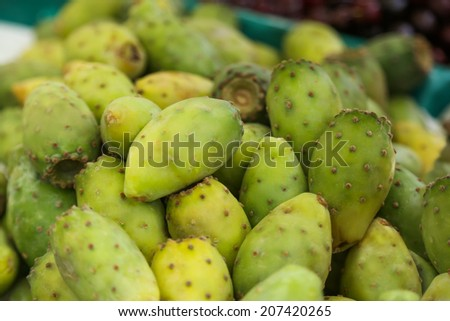 Pile of various prickly pears or cactus fig for sale at a market on Madeira, Portugal - stock photo