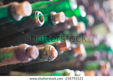 Pile of very old dusty wine bottles. - stock photo