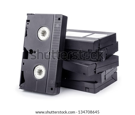 Pile of videotapes on white reflective background. - stock photo