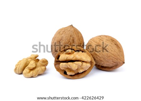 Pile of walnuts isolated on white background - stock photo