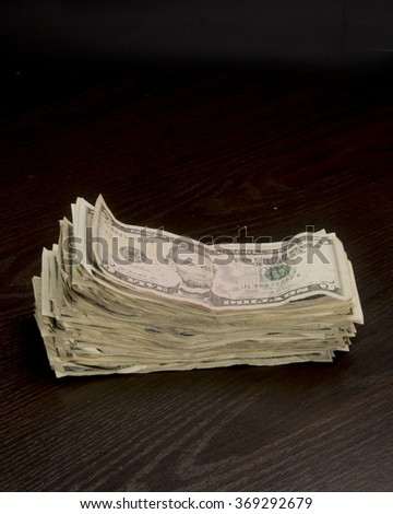 Pile of well used cash/Pile of Cash/Pile of old worn dollar bills - stock photo