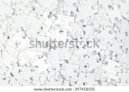 Pile of White Blank Puzzle Pieces Background. - stock photo