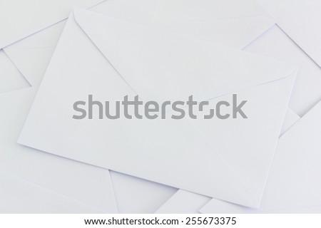 pile of white envelops  on desk - stock photo