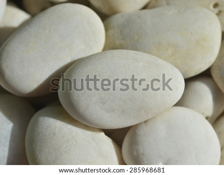pile of white stones for background or texture close-up of the white pebbles, white rocks - stock photo