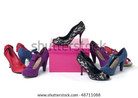 Pile of women's shoes with red gift box - stock photo