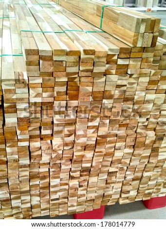 Pile of wood in a warehouse - stock photo