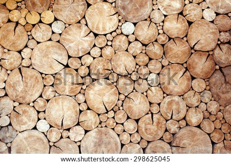Pile of wood logs as background - stock photo