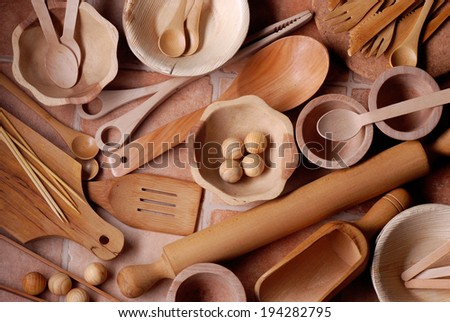 pile of wooden kitchen utensils photographed from above - stock photo