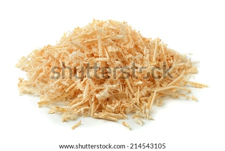 Pile of wooden sawdust and shavings isolated on white - stock photo