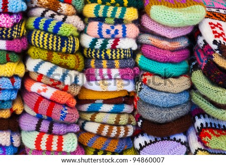 Pile of wool clothing - winter fashion background - stock photo