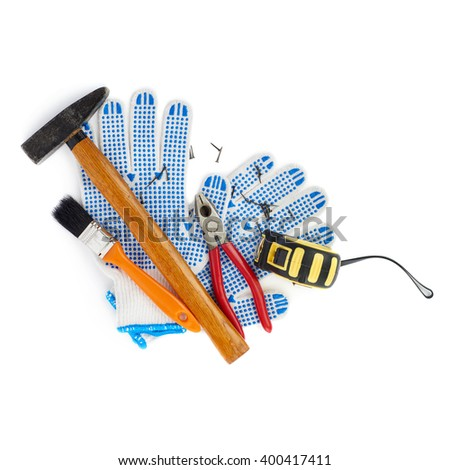 Pile of working tools over isolated white background - stock photo