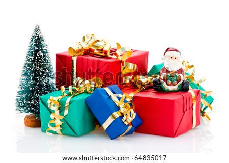 Pile of wrapped Christmas presents with tree and Santa Claus figurine, isolated on white background. - stock photo