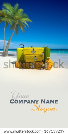 Pile of yellow luggage on a tropical beach - stock photo