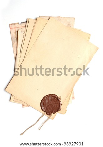 pile old paper with a wax seal on a white background
