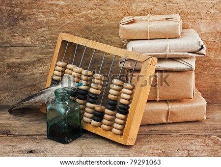 pile parcel wrapped with brown kraft paper and abacus - stock photo