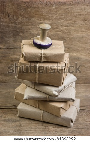 pile parcel wrapped with brown kraft paper and tied with twine - stock photo
