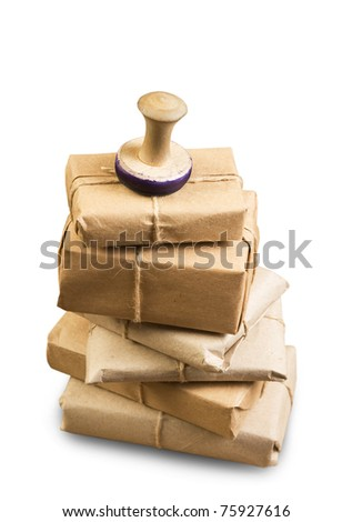 pile parcel wrapped with brown kraft paper isolated on white background - stock photo