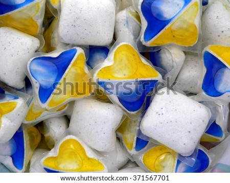 Pile soluble tablets for dishwashers yellow and blue - stock photo