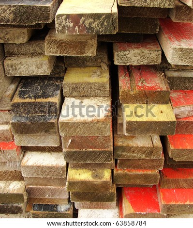 pile stack of colored timber on a construction site