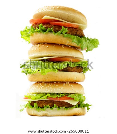 pile traditional cheeseburgers with green lettuce and tomatoes on a white background - stock photo